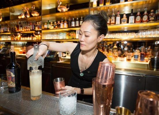 Juyoung Kang preparing a cocktail at The Dorsey at The Venetian Resorts