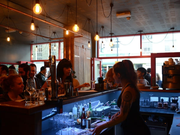 Bar staff member interacting with customers